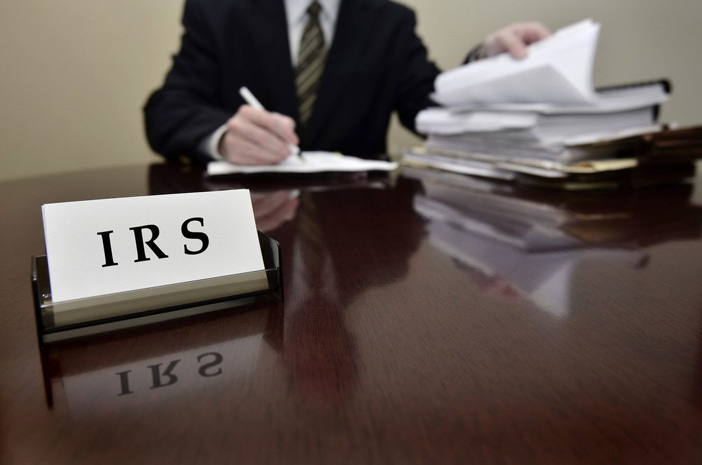 IRS agent reviewing papers